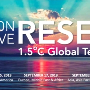 """A banner reads """"Carbon Positive RESET: 1.5 degrees Celsius Global Teach-In"""""""